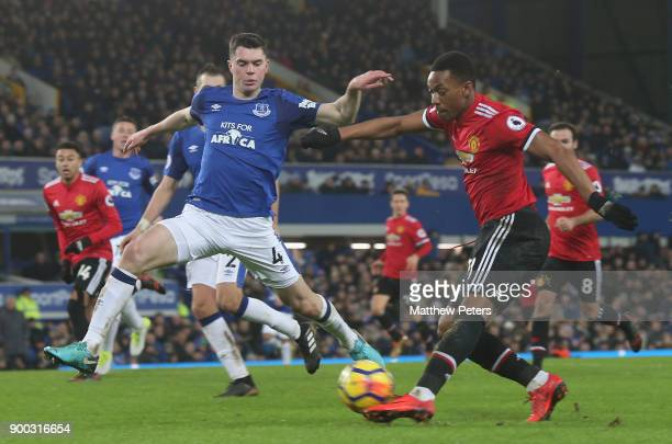 Anthony Martial of Manchester United in action with Michael Keane of Everton during the Premier League match between Everton and Manchester United at...
