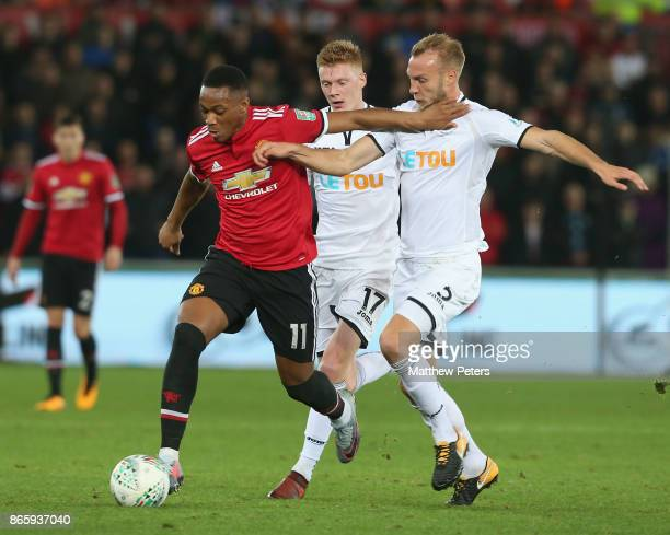 Anthony Martial of Manchester United in action with Mike van der Hoorn of Swansea City during the Carabao Cup Fourth Round match between Swansea City...