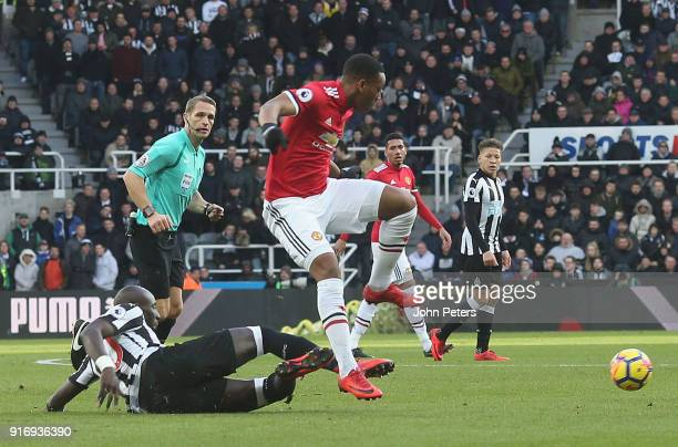 Anthony Martial of Manchester United in action with Mohamed Diame of Newcastle United during the Premier League match between Newcastle United and...