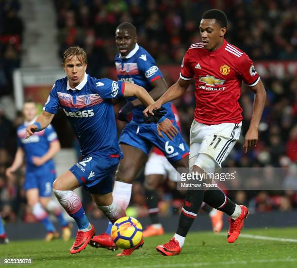 Anthony Martial of Manchester United in action with Moritz Bauer of Stoke City during the Premier League match between Manchester United and Stoke...