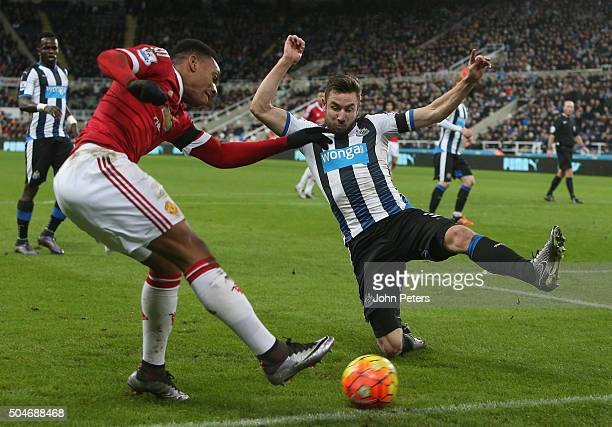 Anthony Martial of Manchester United in action with Paul Dummett of Newcastle United during the Barclays Premier League match between Newcastle...