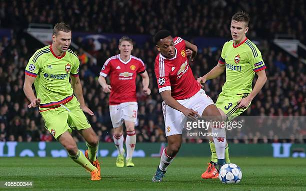 Anthony Martial of Manchester United in action with Pontus Wernbloom and Aleksei Berezutski of CSKA Moscow during the UEFA Champions League match...