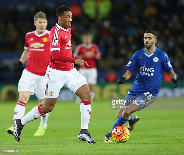 Anthony Martial of Manchester United in action with Riyad Mahrez of Leicester City during the Barclays Premier League match between Leicester City...