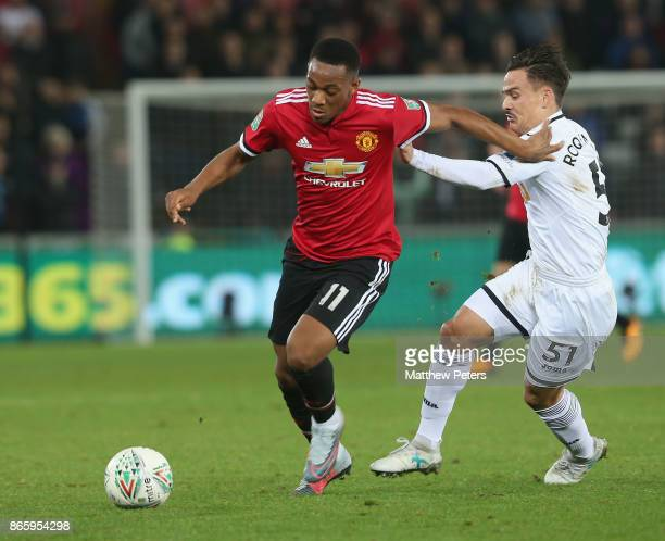 Anthony Martial of Manchester United in action with Roque Mesa of Swansea City during the Carabao Cup Fourth Round match between Swansea City and...