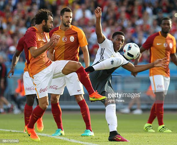 Anthony Martial of Manchester United in action with Selcuk Inan of Galatasary during the preseason friendly match between Manchester United and...