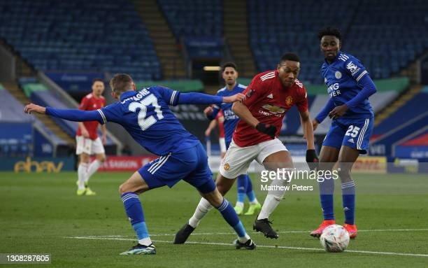 Anthony Martial of Manchester United in action with Timothy Castagne and Wilfred Ndidi of Leicester City during the FA Cup Quarter-Final match...