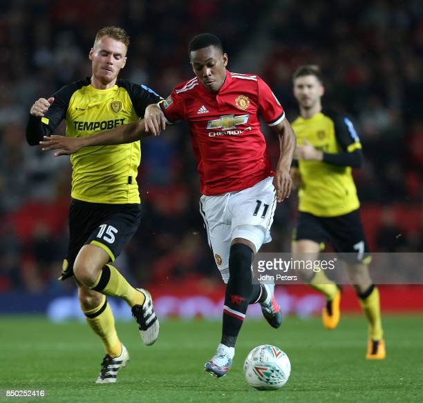 Anthony Martial of Manchester United in action with Tom Naylor of Burton Albion during the Carabao Cup Third Round match between Manchester United...