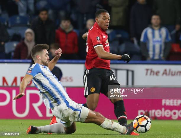 Anthony Martial of Manchester United in action with Tommy Smith of Huddersfield Town during the Emirates FA Cup Fifth Round match between...