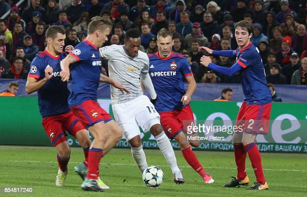 Anthony Martial of Manchester United in action with Vasili Berezutski and Mario Fernandes of CSKA Moscow during the UEFA Champions League group A...
