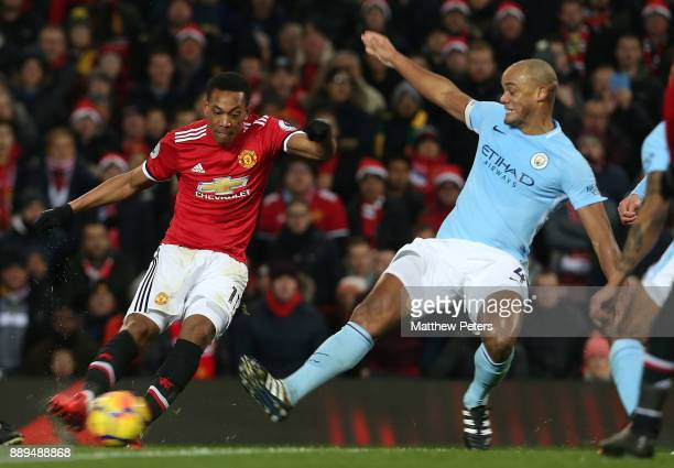 Anthony Martial of Manchester United in action with Vincent Kompany of Manchester City during the Premier League match between Manchester United and...