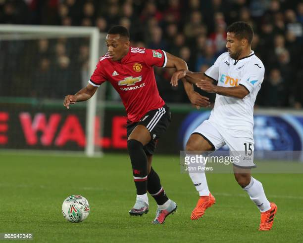 Anthony Martial of Manchester United in action with Wayne Routledge of Swansea City during the Carabao Cup Fourth Round match between Swansea City...