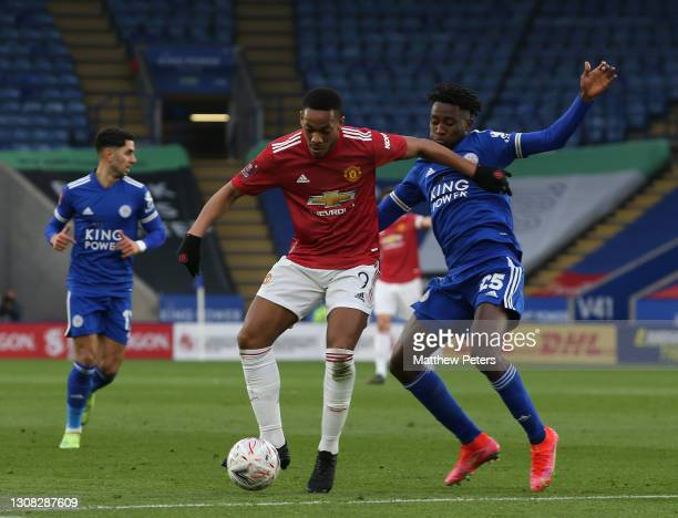 Anthony Martial of Manchester United in action with Wilfred Ndidi of Leicester City during the FA Cup Quarter-Final match between Leicester City and...