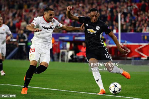 Anthony Martial of Manchester United is challenged by Gabriel Mercado of Sevilla FC during the UEFA Champions League Round of 16 First Leg match...