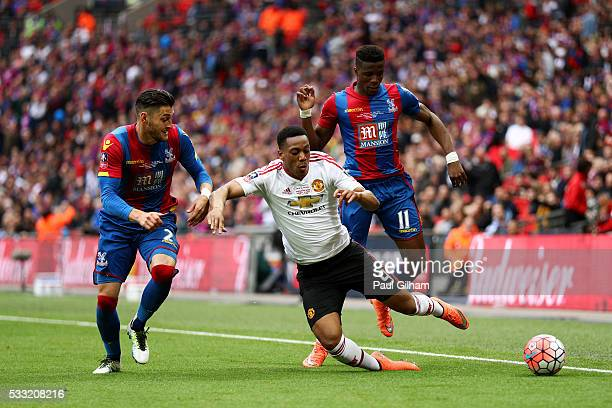 Anthony Martial of Manchester United is challenged by Joel Ward and Wilfried Zaha of Crystal Palace during The Emirates FA Cup Final match between...