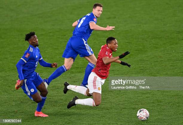 Anthony Martial of Manchester United is challenged by Jonny Evans of Leicester City during the Emirates FA Cup Quarter Final match between Leicester...