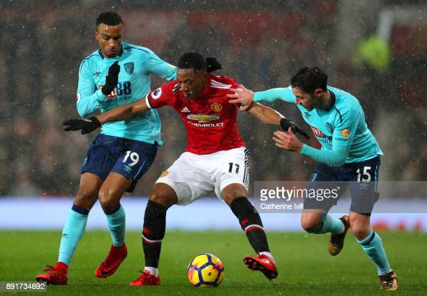 Anthony Martial of Manchester United is challenged by Junior tanislas of AFC Bournemouth and Adam Smith of AFC Bournemouth during the Premier League...