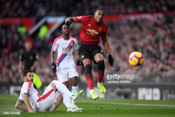 Anthony Martial of Manchester United is challenged by Luka Milivojevic of Crystal Palace during the Premier League match between Manchester United...