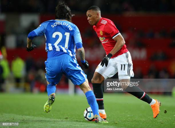 Anthony Martial of Manchester United is challenged by Matias Ezequiel Schelotto of Brighton during the Emirates FA Cup Quarter Final between...