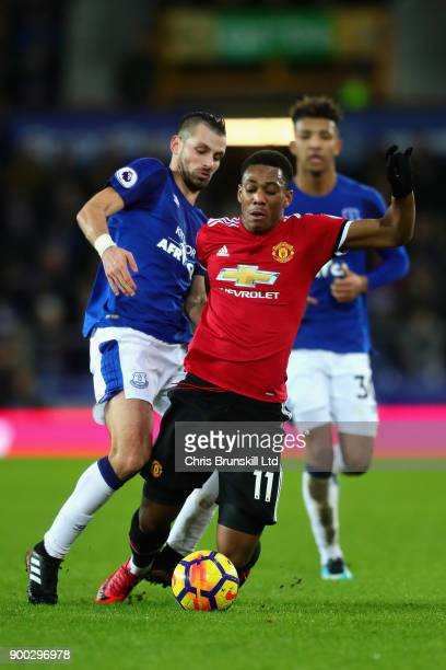 Anthony Martial of Manchester United is challenged by Morgan Schneiderlin of Everton during the Premier League match between Everton and Manchester...