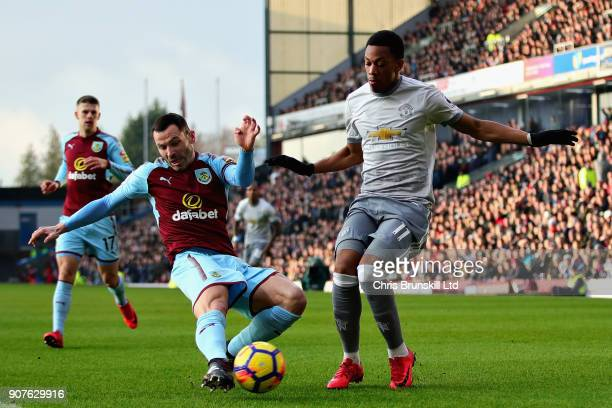 Anthony Martial of Manchester United is challenged by Phil Bardsley of Burnley during the Premier League match between Burnley and Manchester United...