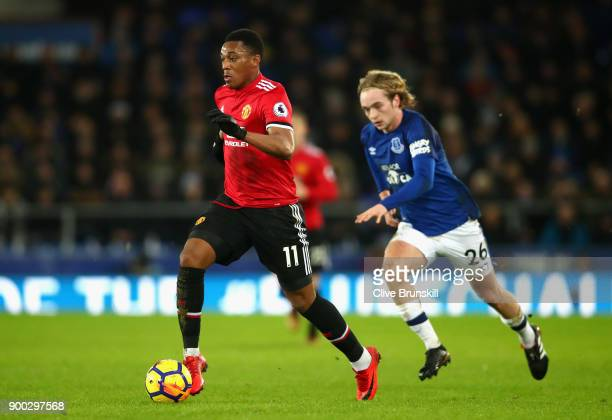 Anthony Martial of Manchester United is chased by Tom Davies of Everton during the Premier League match between Everton and Manchester United at...