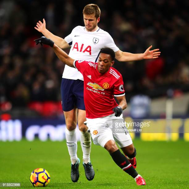 Anthony Martial of Manchester United is chased down by Eric Dier of Tottenham Hotspur during the Premier League match between Tottenham Hotspur and...