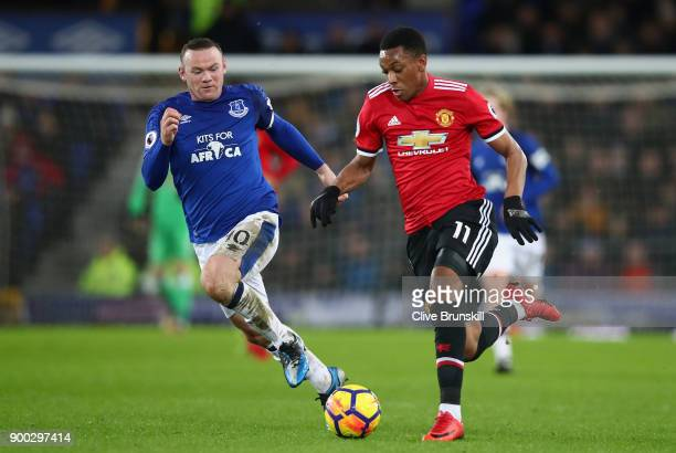 Anthony Martial of Manchester United is chased down by Wayne Rooney of Everton during the Premier League match between Everton and Manchester United...