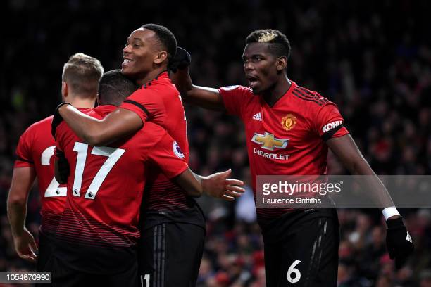 Anthony Martial of Manchester United is congratulated by teammate Paul Pogba after scoring his teams second goal during the Premier League match...