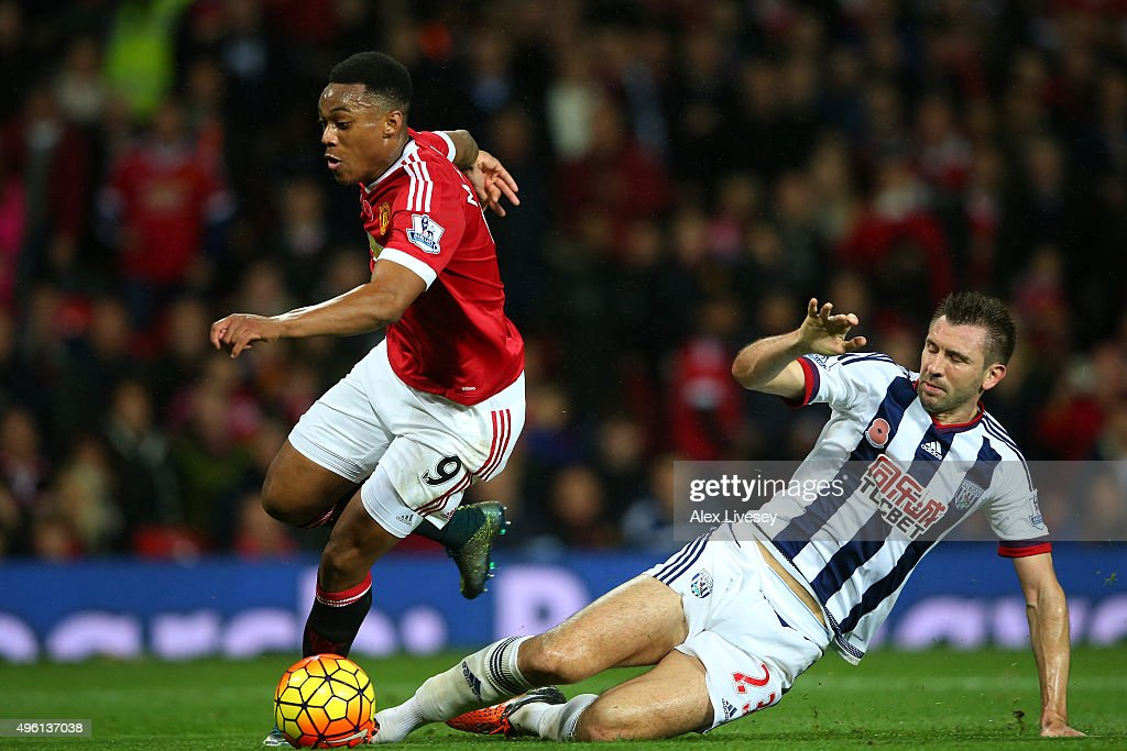 Anthony Martial of Manchester United is fouled by Gareth McAuley of West Bromwich Albion in the penalty area resulting in the Manchester United's second goal during the Barclays Premier League match between Manchester United and West Bromwich Albion at Old Trafford on November 7, 2015 in Manchester, England.