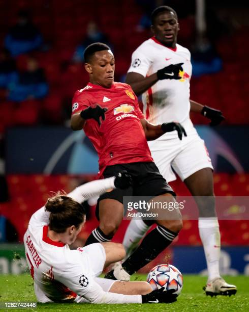 Anthony Martial of Manchester United is fouled by Marcel Sabitzer of RB Leipzig to win a penalty during the UEFA Champions League Group H stage match...