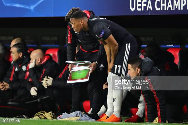 Anthony Martial of Manchester United is given instructions before coming on as a substitute during the UEFA Champions League Round of 16 First Leg...