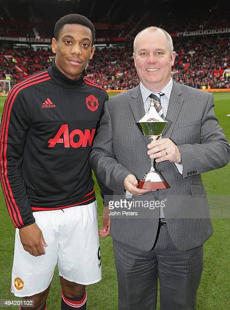 Anthony Martial of Manchester United is presented with the PFA Fans' Player of the Month award ahead of the Barclays Premier League match between...