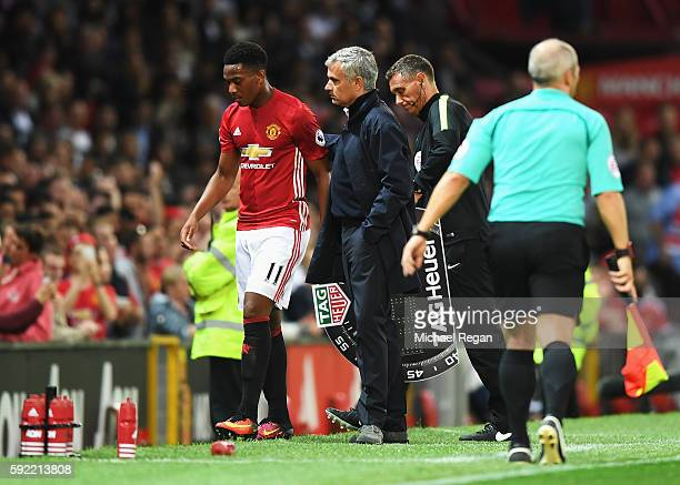 Anthony Martial of Manchester United is substituted by Jose Mourinho Manager of Manchester United during the Premier League match between Manchester...
