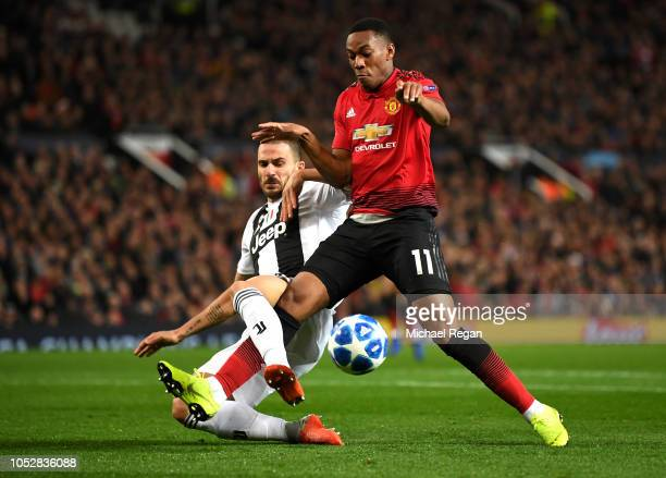 Anthony Martial of Manchester United is tackled by Leonardo Bonucci of Juventus during the Group H match of the UEFA Champions League between...