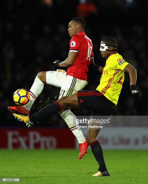 Anthony Martial of Manchester United is tackled by Marvin Zeegelaar of Watford during the Premier League match between Watford and Manchester United...