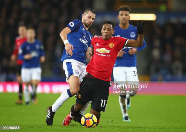 Anthony Martial of Manchester United is tackled by Morgan Schneiderlin of Everton during the Premier League match between Everton and Manchester...