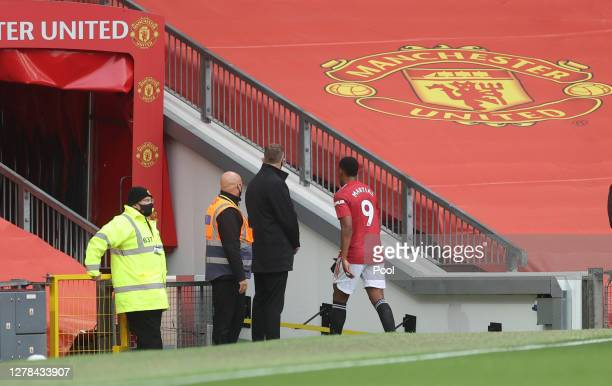 Anthony Martial of Manchester United leaves the pitch after being shown a red card during the Premier League match between Manchester United and...