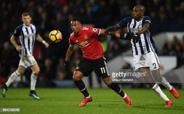 Anthony Martial of Manchester United looks to control the ball under pressure from Allan Nyom of West Bromwich Albion during the Premier League match...