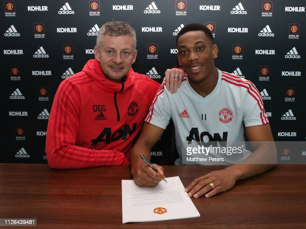 Anthony Martial of Manchester United poses with Caretaker Manager Ole Gunnar Solskjaer after signing an extension to his contract at Aon Training...