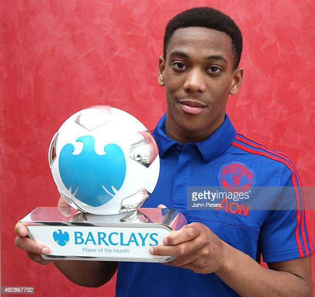 Anthony Martial of Manchester United poses with his Barclays Player of the Month award for September 2015 at Aon Training Complex on October 15 2015...