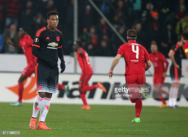 Anthony Martial of Manchester United reacts to Paul Onuachu of FC Midtjylland scoring their second goal during the UEFA Europe League match between...
