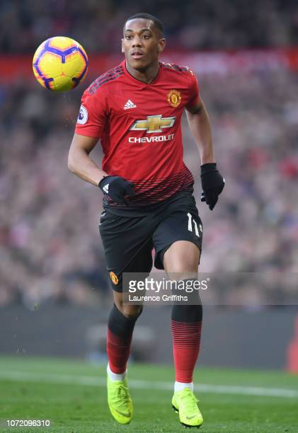Anthony Martial of Manchester United runs with the ball during the Premier League match between Manchester United and Crystal Palace at Old Trafford...