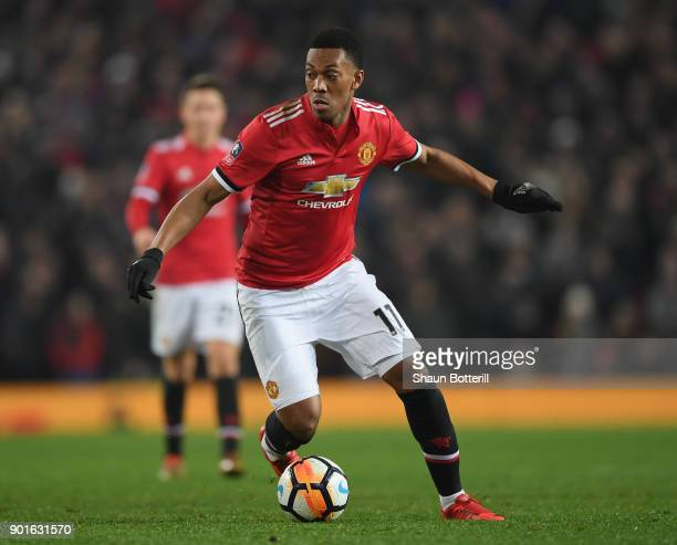 Anthony Martial of Manchester United runs with the ball during the Emirates FA Cup Third Round match between Manchester United and Derby County at...