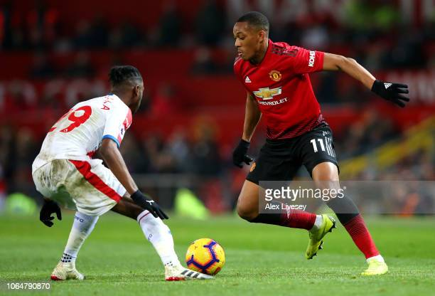 Anthony Martial of Manchester United runs with the ball towards Aaron WanBissaka of Crystal Palace during the Premier League match between Manchester...