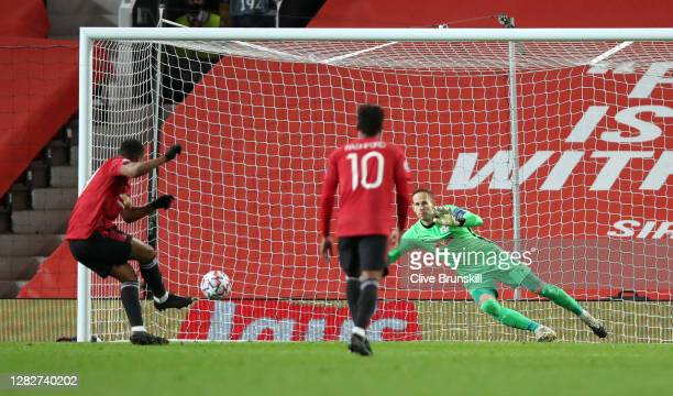 Anthony Martial of Manchester United scores his sides fourth goal from the penalty spot past Peter Gulacsi of RB Leipzig during the UEFA Champions...