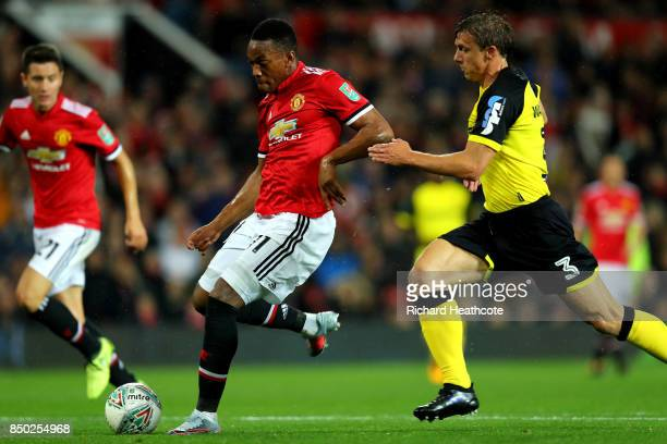 Anthony Martial of Manchester United scores his sides fourth goal during the Carabao Cup Third Round match between Manchester United and Burton...