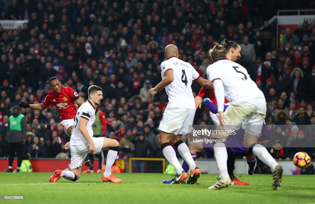 Anthony Martial (1st L) of Manchester United scores his side's second goal during the Premier League match between Manchester United and Watford at Old Trafford on February 11, 2017 in Manchester, England.