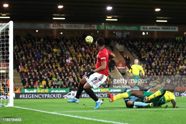 Anthony Martial of Manchester United scores his sides third goal past Tim Krul of Norwich City during the Premier League match between Norwich City...