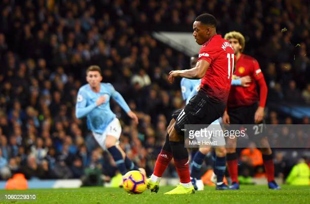 Anthony Martial of Manchester United scores his team's first goal during the Premier League match between Manchester City and Manchester United at...