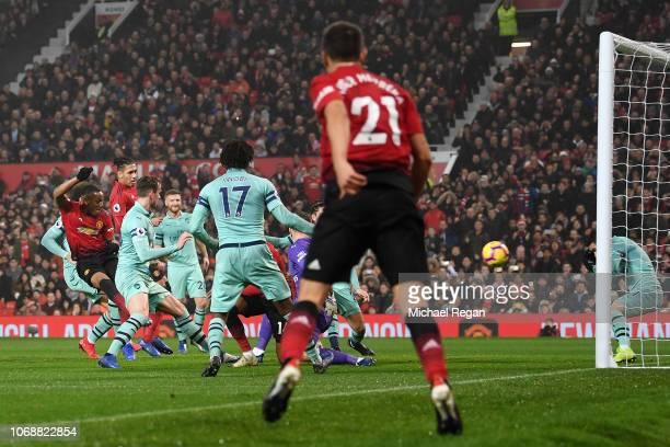Anthony Martial of Manchester United scores his team's first goal during the Premier League match between Manchester United and Arsenal FC at Old...